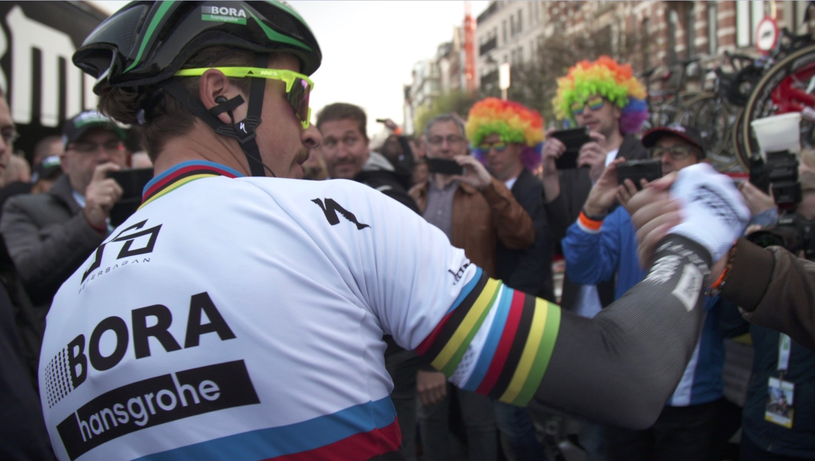 World Champion Peter Sagan shakes hands with fans at the start of the Tour of Flanders